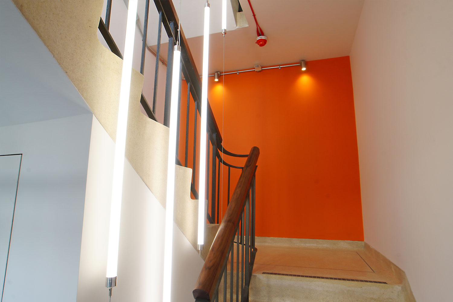 Orange wall on stairs